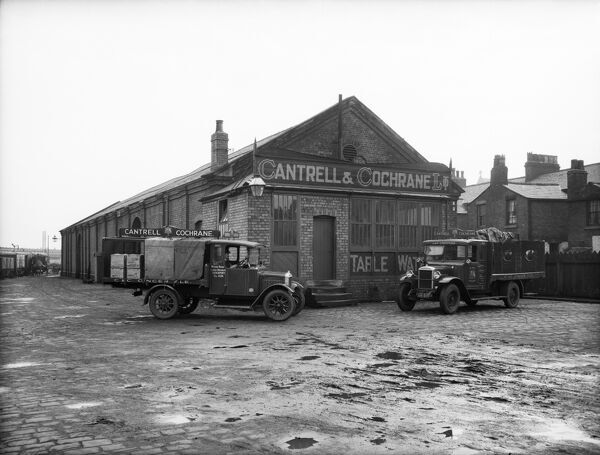 Goods Shed, West Lancashire Station, Fishergate Hill, Preston. Two vans parked outside the Cantrell and Cochrane depot. Photographed in 1927 for the London, Midland and Scottish Railway. The station was also known as Fishergate Hill Station