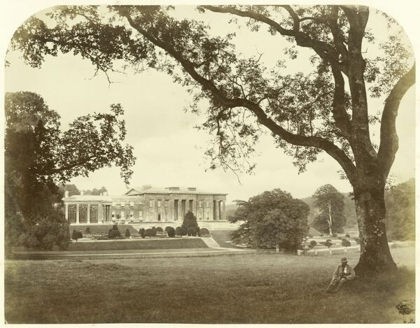 "The Grange, Northington, Hampshire. Albumen print of ""c.1869 by an unknown photographer. The photographer has artistically used trees to frame the building and the seated figure gives scale to the composition. The Grange had originally been built between 1667"