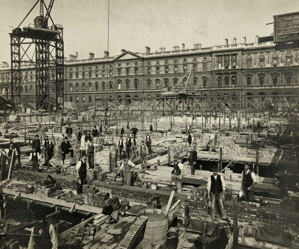 Construction of the New Government Offices, Great George Street, Westminster, London, 24 September 1902. S B Bolas & Co, silver gelatin DOP (developing out paper) print. Work stops for a few moments during the building of New Government Offices