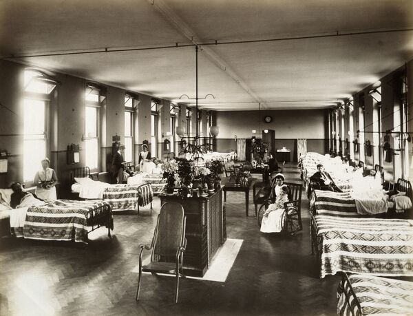 GREAT NORTHERN CENTRAL HOSPITAL, Holloway Road, London. Interior view of the number 2 Male Ward showing nursing staff and patients. Photographed by Bedford Lemere, 11th June 1888