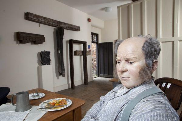GREAT YARMOUTH ROW HOUSES, Norfolk. Interior view with mannequin. Kitchen vignette from north west - Old Merchant's House