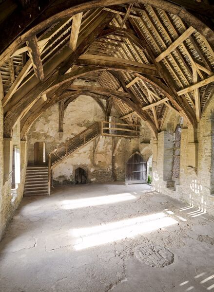 STOKESAY CASTLE, Shropshire. Interior view of the Hall showing the timber staircase and cruck roof