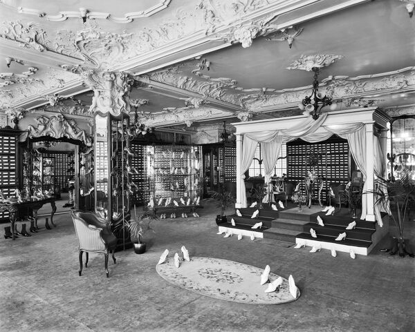 HARRODS, Brompton Road, Knightsbridge, London. Baroque luxury of the ladies shoe department in Harrods. The ornate plaster ceiling and the lavish use of space emphasise the exclusive nature of the store. It was rebuilt following a fire in 1884