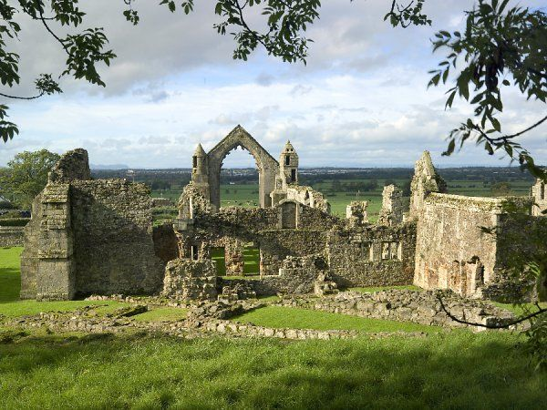 HAUGHMOND ABBEY, Shropshire. View of the Augustinian abbey along the Abbot's range from the east