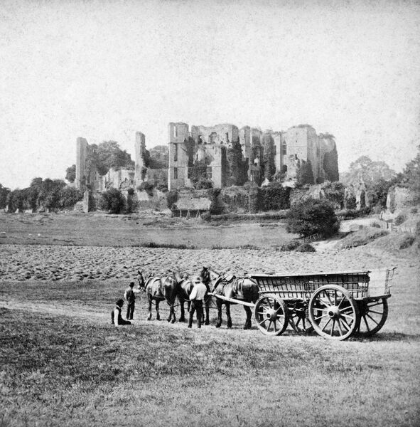 KENILWORTH CASTLE, Warwickshire. A Victorian hay cart at rest in front of the ivy-clad remains of Kenilworth Castle