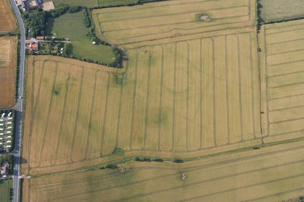 Neolithic henge reused as a Bronze Age ringwork in Hornsea, East Yorkshire   Historic England's aerial reconnaissance team spotted the buried remains of this rare and unusual prehistoric site during a dry summer