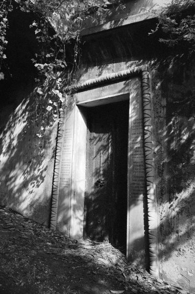 HIGHGATE CEMETERY, Hampstead, London. The entrance to a family catacomb in Egyptian Avenue in the West Cemetery. Photographed by John Gay in March 1991
