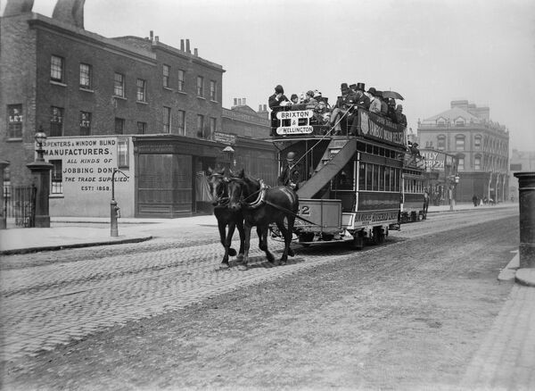 "South London (uncertain location). A double-decker horse tram on the route between Brixton and ""Lord Wellington"" (probably a public house of the same name). Photographed sometime around 1900"