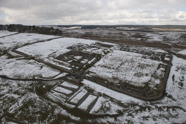 Vercovicium Roman Fort, Housesteads, Northumberland. Low-level aerial view with a light covering of snow. NY7968/244