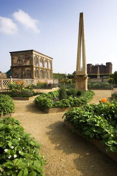 KENILWORTH CASTLE, Warwickshire. The Elizabethan Garden near completion. General view of obelisk and aviary