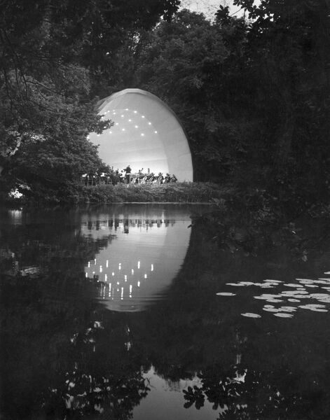 KENWOOD HOUSE CONCERT BOWL, Hampstead, London. Looking across the lake towards an evening open air concert in the grounds of Kenwood House. Photographed by John Gay during 1950s-1960s