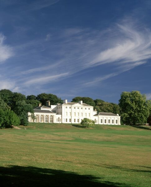KENWOOD HOUSE, London. Exterior view. A view of the grounds and the south front from the south west