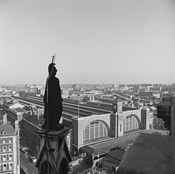 KINGS CROSS STATION, London. Looking towards the railway station from the roof of the St. Pancras Hotel with statue of Britannia in the foreground. Photographed by John Gay. Date range: 1960 - 1972