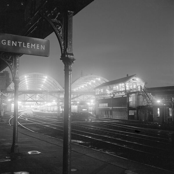 KINGS CROSS STATION, Euston Road, London. A view at night from the platform at Kings Cross York Road station looking back towards the illuminated signal box and train sheds at Kings Cross. Date range 1960 - 1972. John Gay
