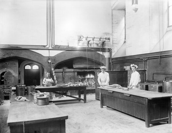NEW COLLEGE, Oxford, Oxfordshire. Cooks at work in the college kitchens. The men are preparing joints of meat and a spit of chickens is leaning against the wall, ready to be roasted. Photographed by Henry Taunt in 1901
