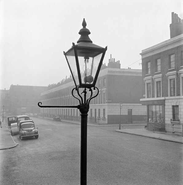 DAME STREET, Islington, London. A view south into a section of Dame Street, showing the top of a lamp post in the foreground, and terraced houses beyond. John Gay. Date range: 1955-1965