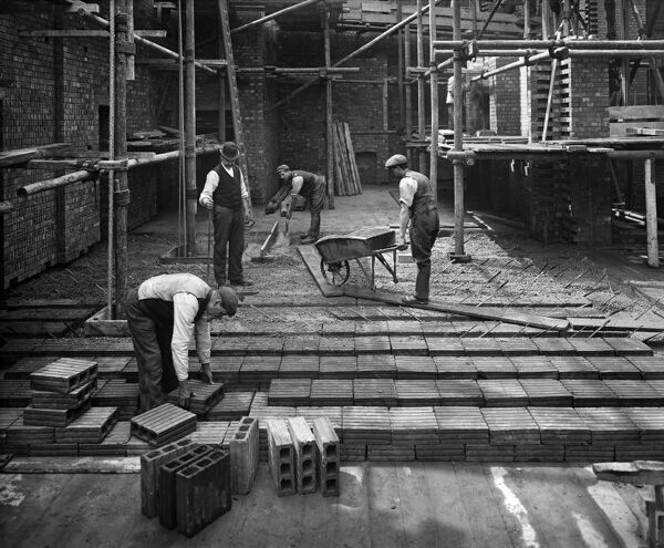 8 LLOYDS AVENUE, City Of London. Construction workers laying a 'hollow pot' reinforced concrete floor at number 8 Lloyds Avenue