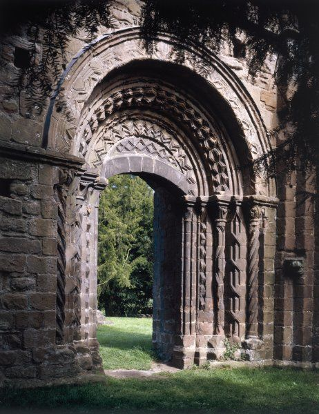 LILLESHALL ABBEY, Shropshire. The highly decorated Norman processional arch from the cloisters into the church