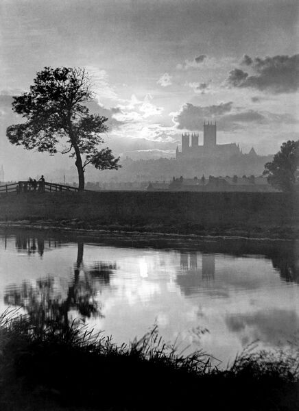 LINCOLN CATHEDRAL, Lincolnshire. A misty view with Lincoln Cathedral in the distance taken from the Swanpool. The Cathedral dates back to 1092 with later additions and remodelling. Photograph taken January 1949