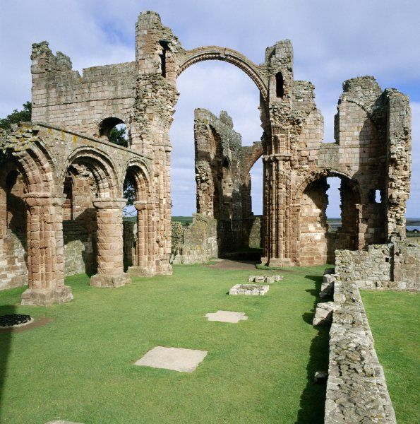 LINDISFARNE PRIORY, Northumberland. The church nave. View from the South West with the Rainbow Arch