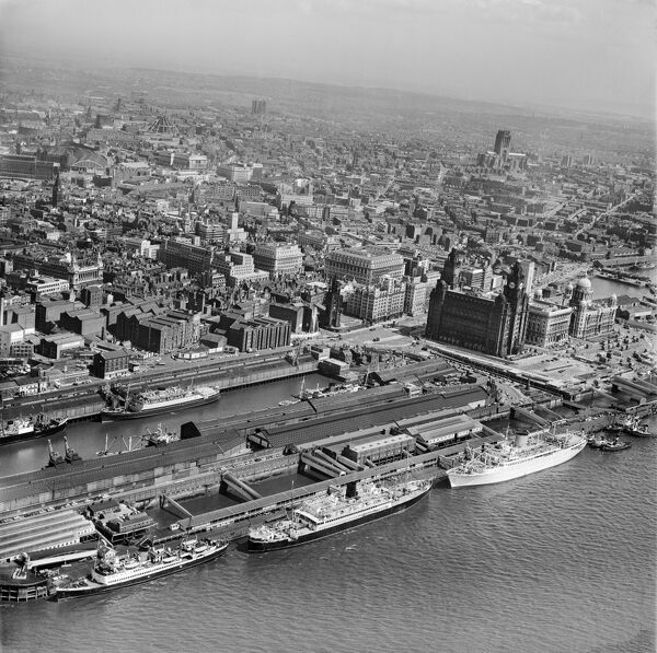 PIER HEAD, Liverpool. Aerial photograph of the Prince's Dock and Prince's Landing Stage, with the Three Graces beyond in July 1964