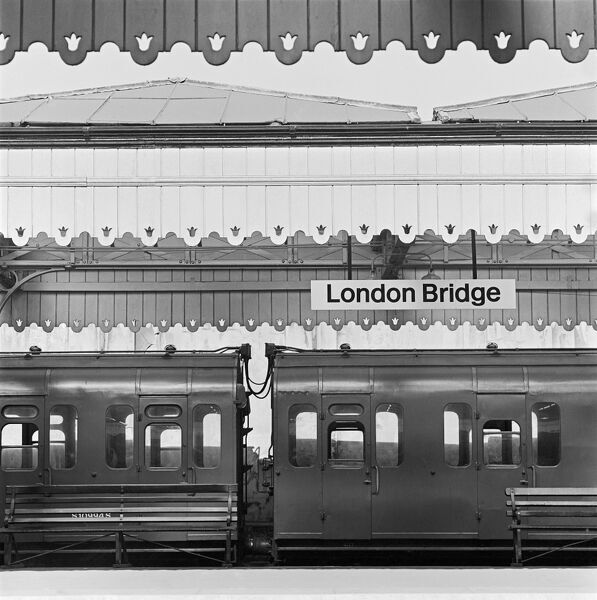 LONDON BRIDGE STATION, Southwark, London. A view looking across to a train standing beneath the decorative bargeboards of a platform roof at London Bridge Station. Date range:1960-1972. John Gay