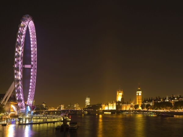 THE LONDON EYE. Night view of the London Eye and Palace of Westminster including the Big Ben clock tower