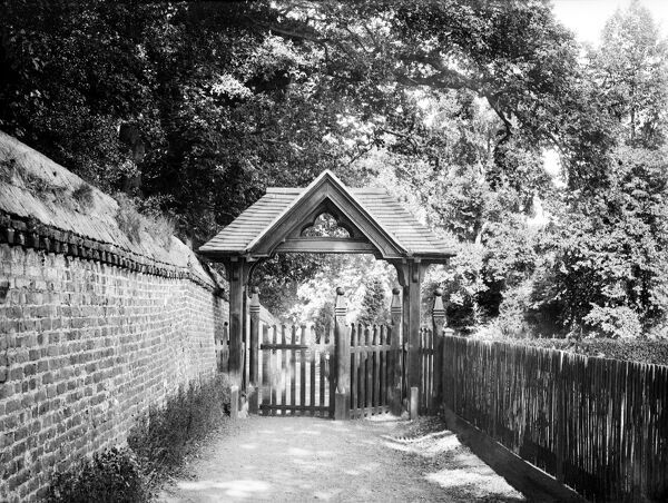 ST ANDREWS CHURCH, Sonning, Berkshire. The wooden lych gate of the church, built in the Victorian period, with a narrow lane behind. Photographed by Henry Taunt (active 1860 - 1922)
