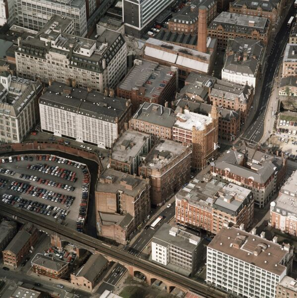 Whitworth Street/Princess Street, Manchester. This aerial photograph shows the cotton warehouse district of Manchester, most of which date from the late 19th and early 20th centuries. Manchester at this time was the focus of the Lancashire cotton industry