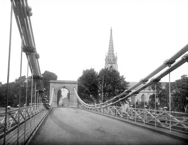 MARLOW BRIDGE, Marlow, Buckinghamshire. Looking along the suspension bridge over the River Thames, which was built in 1829-31. The spire of All Saints Church is in the background. Photographed by Henry Taunt (active 1860-1922).