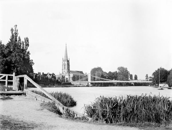 MARLOW, Wycombe, Buckinghamshire. View looking east along the Thames towards the suspension bridge and the parish church