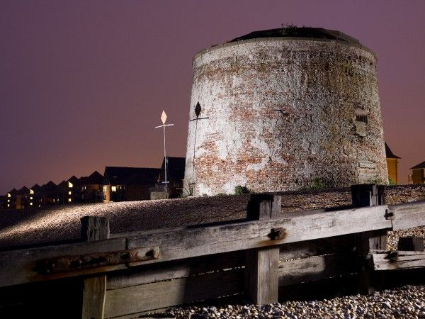 MARTELLO TOWER, No. 64, Eastbourne, East Sussex. Twilight view of the Martello Tower from the beach