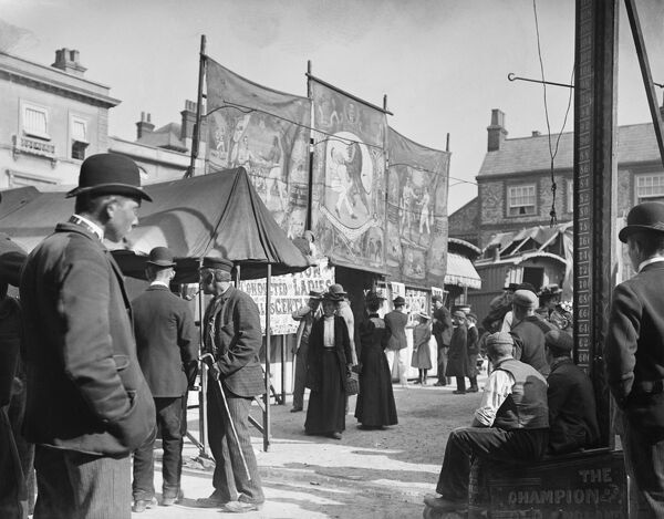 Market Place, Wallingford, Oxfordshire. People looking at the stalls at the Michaelmas Fair in the Market Place. 1895, unknown photographer