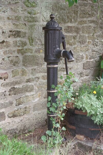 Mid C19 cast iron pump with a long curved handle and spout. IoE 399999