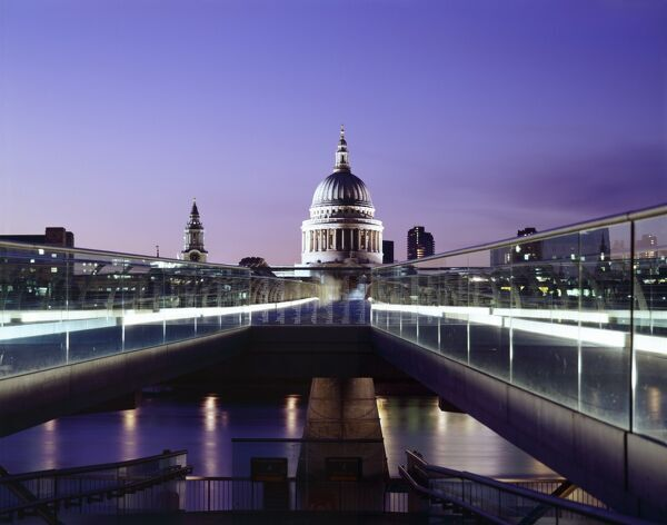 MILLENNIUM BRIDGE, London. The southern approach to the bridge looking towards St Pauls at dusk / night