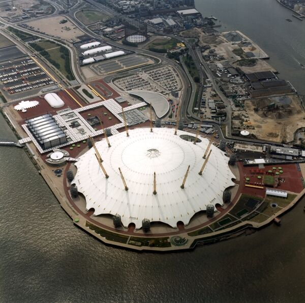 Millennium Dome, Greenwich, London. An aerial view of the Millennium Dome situated on a former gas works site by the River Thames. It was erected in 1997-9 to house a huge visitor attraction for the Millennium. It has a circumference of 1km and is 50m high