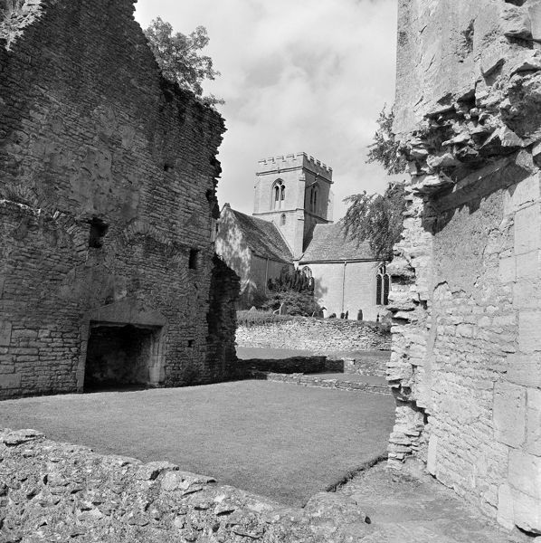 MINSTER LOVELL HALL, Manor Road, Minster Lovell, Oxfordshire. The remains of Minster Lovell Hall with St Kenelm's Church beyond. Photographed by John Gay in 1970