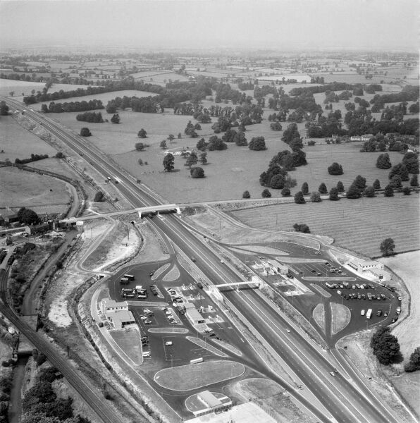 M1 MOTORWAY. Aerial view of the motorway and the service station at Newport Pagnell, after opening to all traffic in 1960. This was the second motorway service station built in England, but the first to accomodate cars. Photograph taken in July 1961