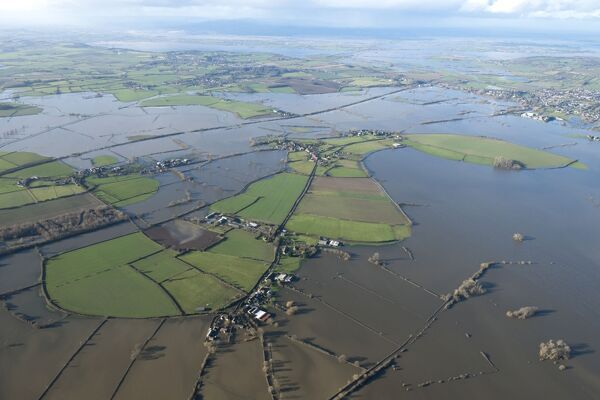 Muchelney Abbey, Somerset Levels. Aerial view of flooding in January 2014. ST4223/4