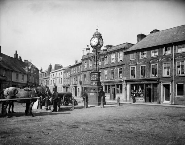 NEWBURY, Berkshire. The clock that commemorates the Golden Jubilee of Queen Victoria (1887) stands at the three-way junction of the London and Bath roads in the town. Photographed in 1890 by Henry Taunt.