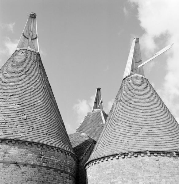 COBHAM, Kent. Detail of traditional conical roofs and cowls of oasthouses near Cobham. Photographed by Eric de Mare in 1956