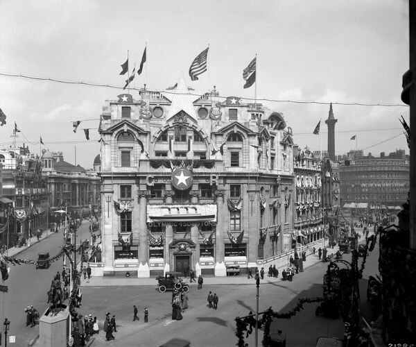 OCEANIC HOUSE, Cockspur Street, London. The London office of the White Star Line shipping company decorated for George V coronation (22nd June 1911) including an image of the RMS Olympic ocean liner who's maiden voyage commenced 14th June
