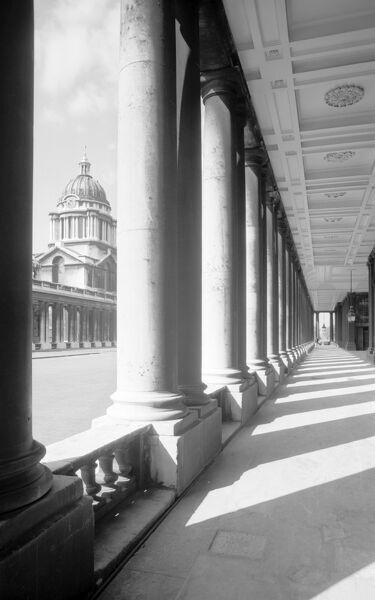 OLD ROYAL NAVAL COLLEGE, Greenwich, London. Exterior perspective view of the college looking along the colonnade. The main building work took place between 1696 and 1712, although it was not completely finished until 1752. Photographed by Eric de Mare