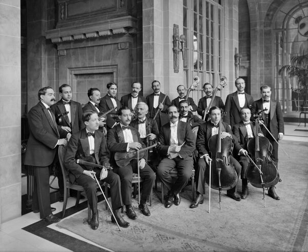 MIDLAND ADELPHI HOTEL, Liverpool. Interior view. Group portrait of the hotel orchestra. The hotel was re-opened in 1914 after partial rebuilding and refurbishment in the Neo-Classical style. Close to Lime Street Railway Station the Adelphi remains open today