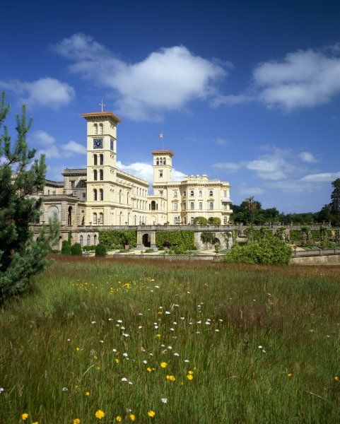 OSBORNE HOUSE, Isle of Wight. Exterior view showing the Italianate towers with grassland in the foreground