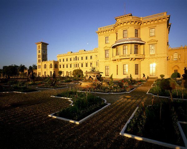 OSBORNE HOUSE, East Cowes, Isle of Wight. Exterior view of the house and upper terrace at dusk