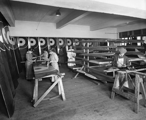 WARING AND GILLOW FACTORY, Cambridge Road, Hammersmith, London W6. Inside the factory showing women and boys painting the wings of aircraft for use during the First World War. Photographed in 1916 by Bedford Lemere and Co