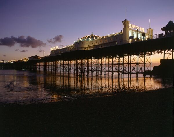 THE PALACE PIER, Brighton, East Sussex. View of the pier at sunset