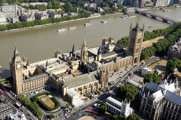 PALACE OF WESTMINSTER, London. Aerial view of the Houses of Parliament and the River Thames