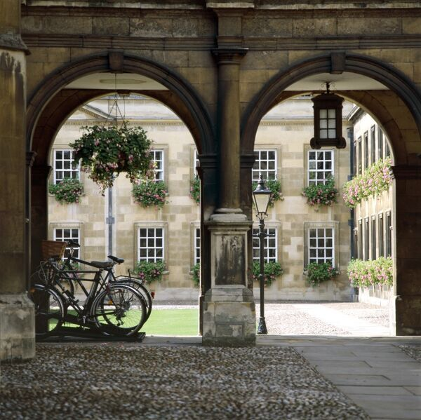 PETERHOUSE COLLEGE, Cambridge, Cambridgeshire. View of the arcade with bicycles